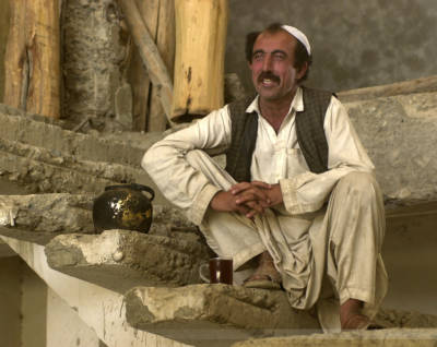 Tea-time during house construction, Udkhal, Afghanistan, July 2004